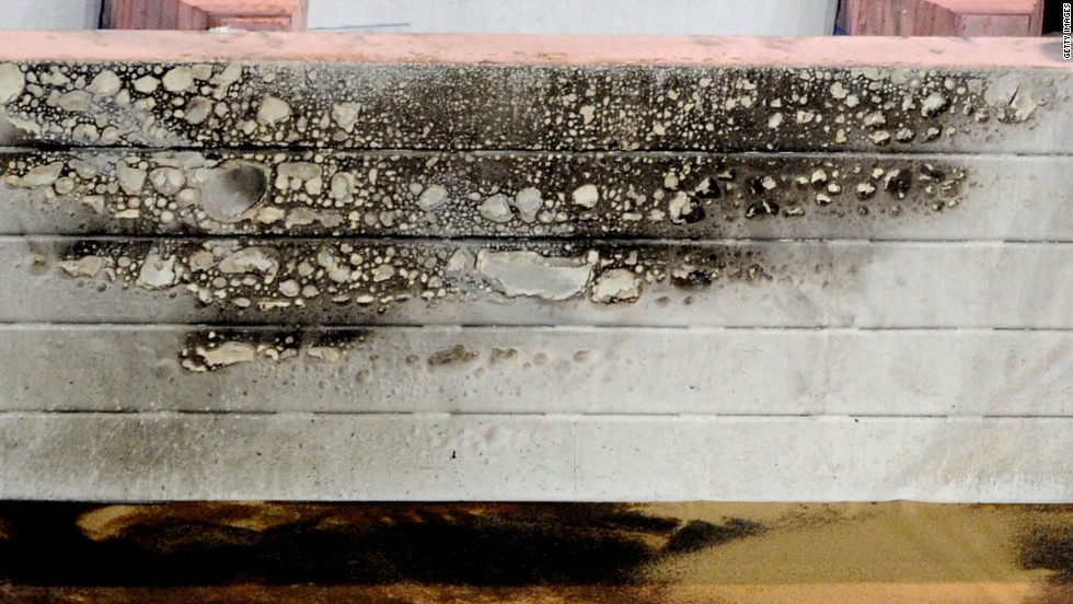 This safety barrier shows the impact of the flames which engulfed a section of the track.