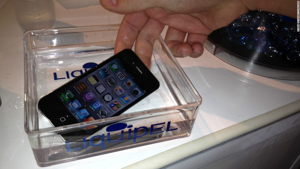 An iPhone waterproofed using a substance called Liquipel is submerged at the 2012 Mobile World Congress in Barcelona, Spain.
