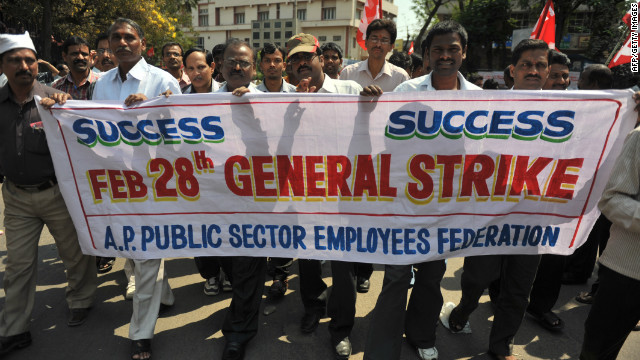 Members of Trade unions and left-wing political parties participate in a protest rally during the one day general strike in Hyderabad.