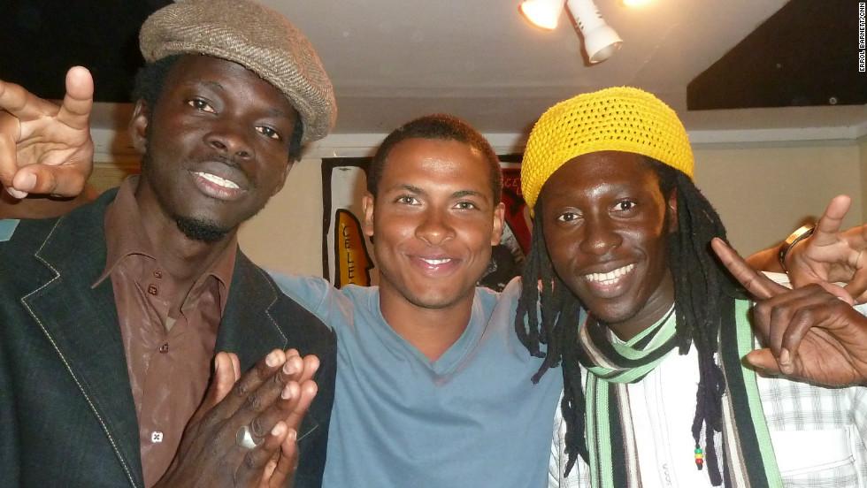 CNN's Errol Barnett with Daara J Family's N'Dongo D (left) and Faada Freddy (right).