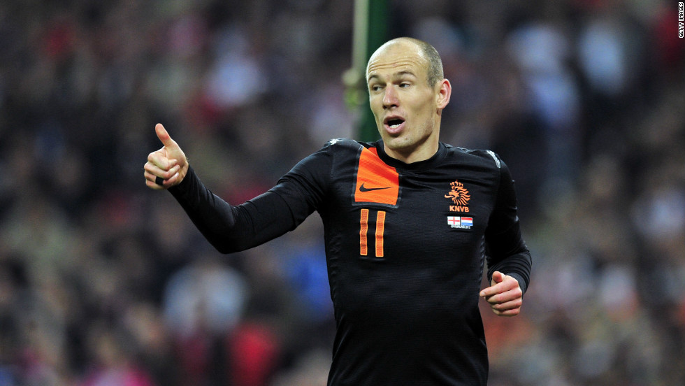 Arjen Robben wheels away after scoring the first of his goals for the Dutch at Wembley.