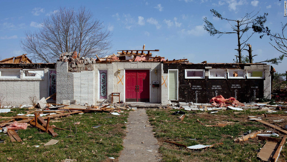 A house in Harrisburg lies in ruins in the tornado's aftermath.