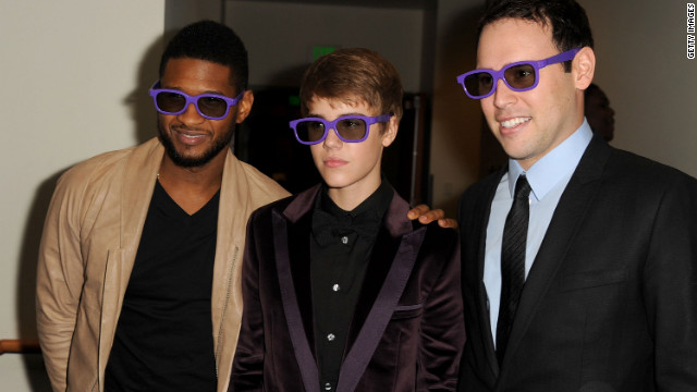 "Justin Bieber (center) announced on Twitter that the album ""Believe"" will also include a duet with Usher (left)."