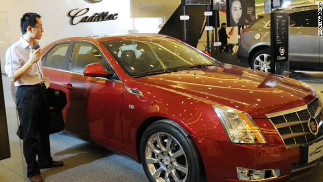 A man looks at a Cadillac as the US manufactured car is promoted at a shopping mall in Beijing on October 21, 2011.