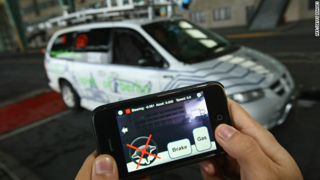 A student at the Freie Universitaet Berlin steers a converted Dodge minivan remotely with an iPhone in November 2009.