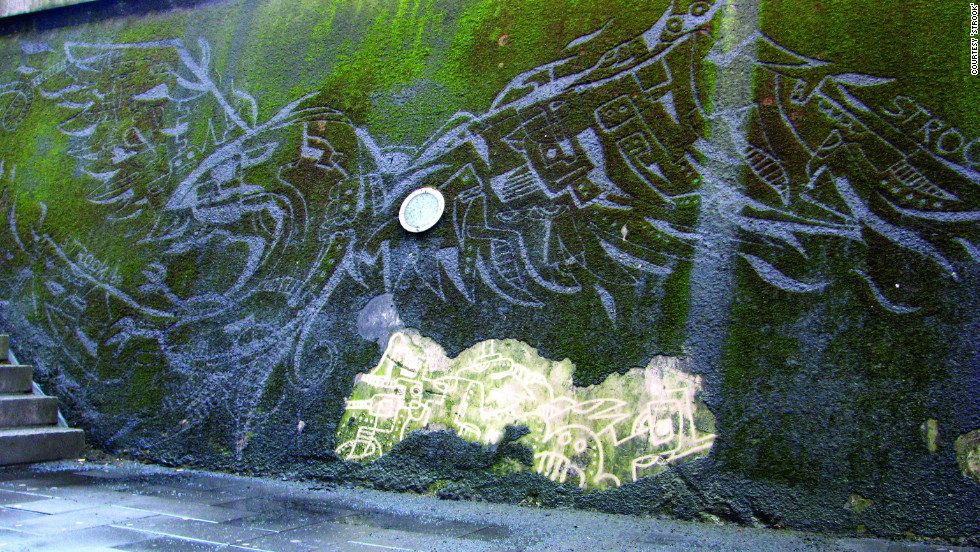"Belgian graphic designer <a href=""http://www.strook.eu/"" target=""_blank"">Strook</a> used a moss-covered wall in his home city of Leuven as a canvas -- employing a power-washer to create what he calls ""reverse graffiti."" He created this bird mural by cleaning  moss off, rather than spraying paint on. ""A filthy wall became something attractive,"" he says. I hope some people will look at the wall in a different way and discover the beauty of nature."""