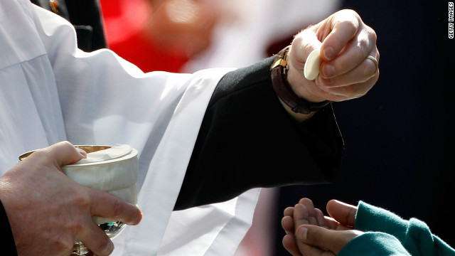 Pilgrims receive Holy Communion outside Westminster Cathedral as Pope Benedict XVI conducts Mass on September 18, 2010