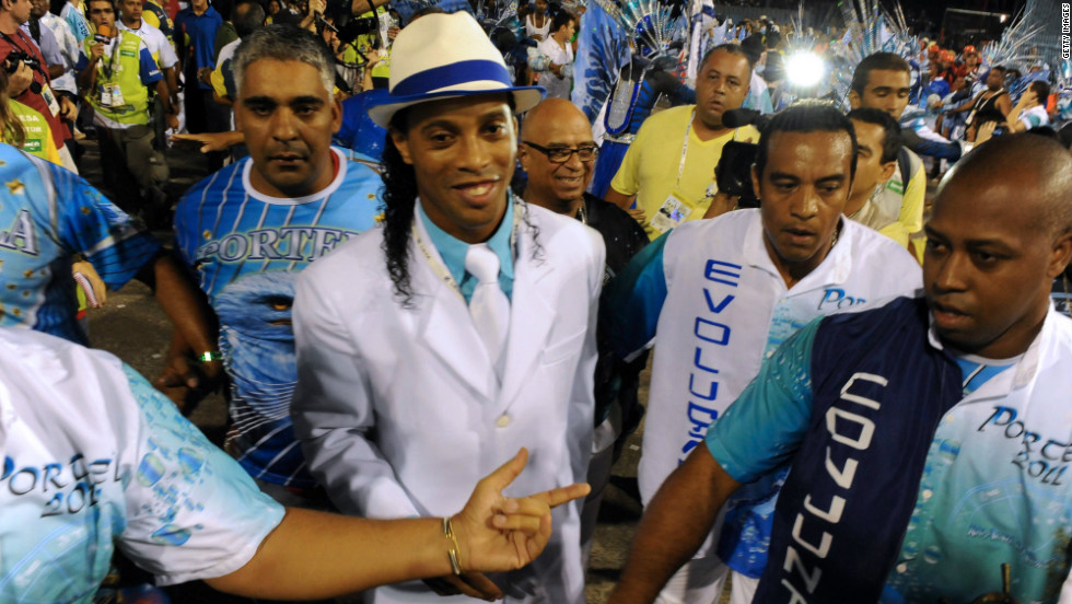 Like Neymar, Ronaldinho also enjoys letting loose during the carnival. He is pictured here dancing with a samba school in Rio during the 2011 carnival.