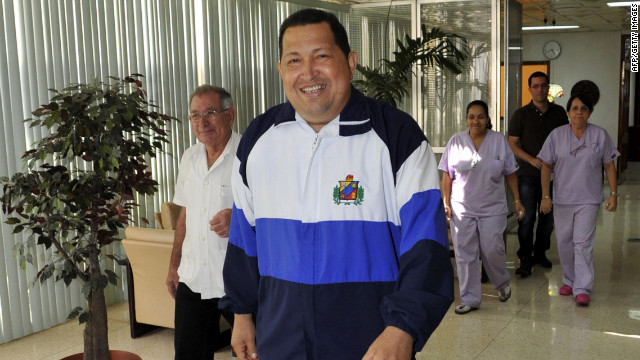 In a photo released Friday, Hugo Chavez walks through the hospital in Havana, Cuba, where he was treated.