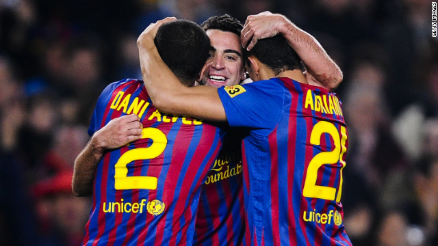 Xavi (center) celebrates with Dani Alves and Adriano as Barcelona beat Sporting Gijon 3-1 at the Nou Camp.