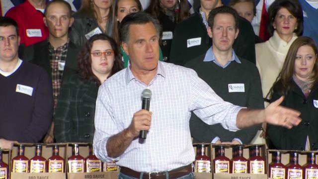Romney takes aim at Obama