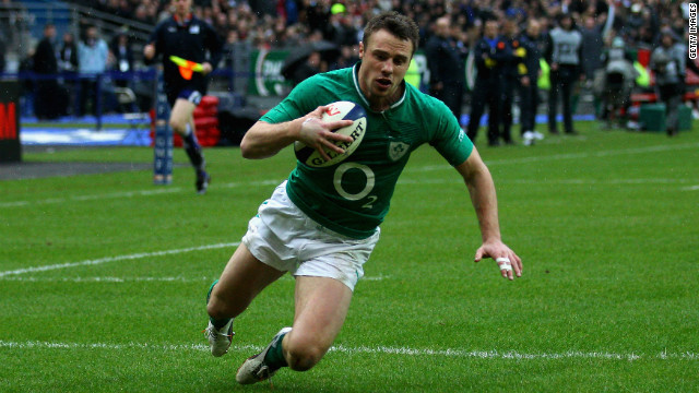 Tommy Bowe dives over for his second try at the Stade de France against France.