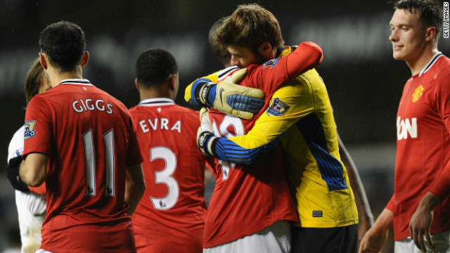 Manchester United's Ashley is congratulated by goalkeeper David de Gea after his match-winning brace.