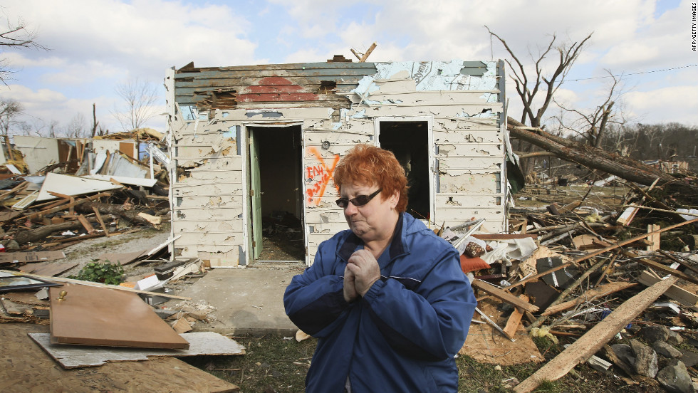 Janet Clark stands in front of her home on Sunday, March 4, where she rode out Friday's EF4 tornado in Henryville, Indiana.