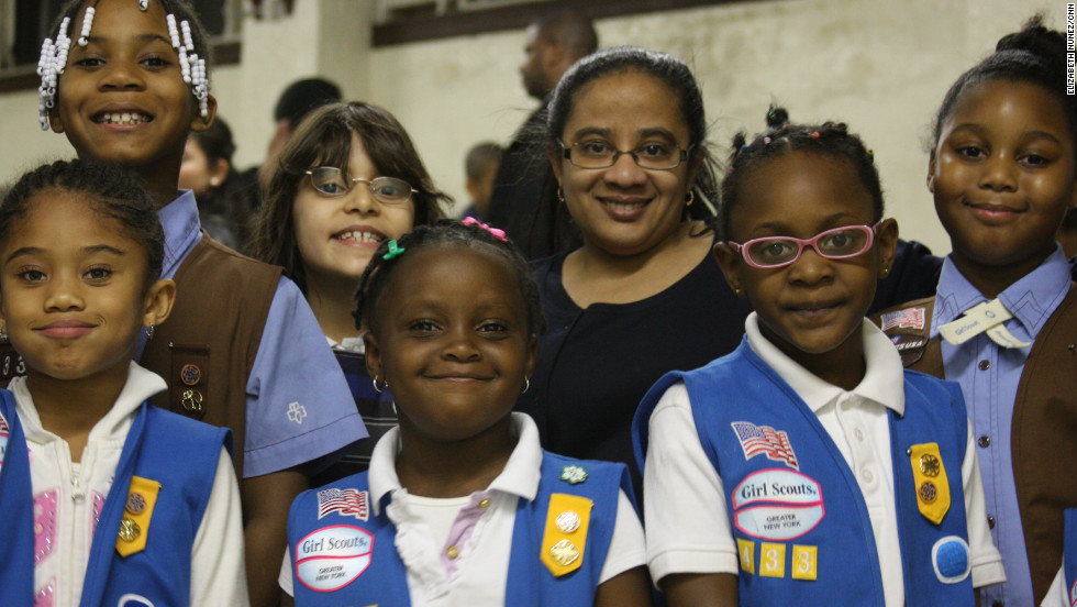 "<strong>NALDA GOMES, 43</strong>, and other volunteers lead Daisy troop 4338 (ages 5 to 6), Brownie troop 4330 (ages 7 to 8) and Junior troop 4326 (ages 9 to 10) in Queens Village in New York City. Most girls have Latino, Caribbean or African-American backgrounds. Gomes was a Girl Guide in her native Antigua, in the Caribbean, before moving to the U.S. at age 13. ""All international Girl Scouts are considered Girl Guides, only in the states are they called girl scouts,"" she explained. ""I'm a registered nurse. I work at St. Luke's Roosevelt hospital as a clinical educator."""