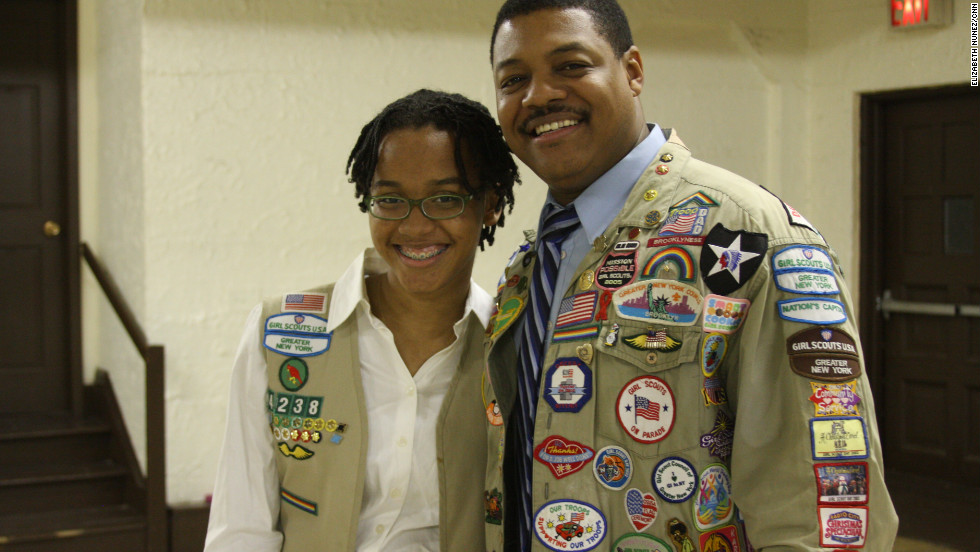 "<strong>MALCOLM ROBERTSON's</strong> four daughters have all been Girl Scouts. His third, Alexis, 16, is on her Twelfth year as a scout and is now a cadet in queens. ""I was thinking about becoming a troop leader later but I really want to become a medical examiner first"" she said. Her father, who teaches sixth grade social studies and science, values that the girls get to do things they normally wouldn't. ""It's a good environment, it's a good way to be involved in the community and... in service"", he said."
