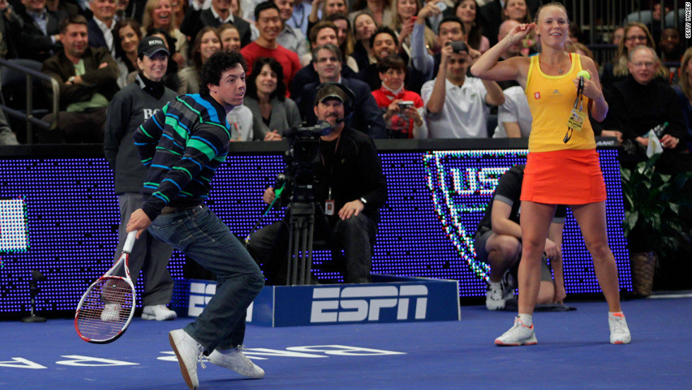 Golf ace Rory McIlroy shows he is a dab hand at tennis with a backhand return against Maria Sharapova.