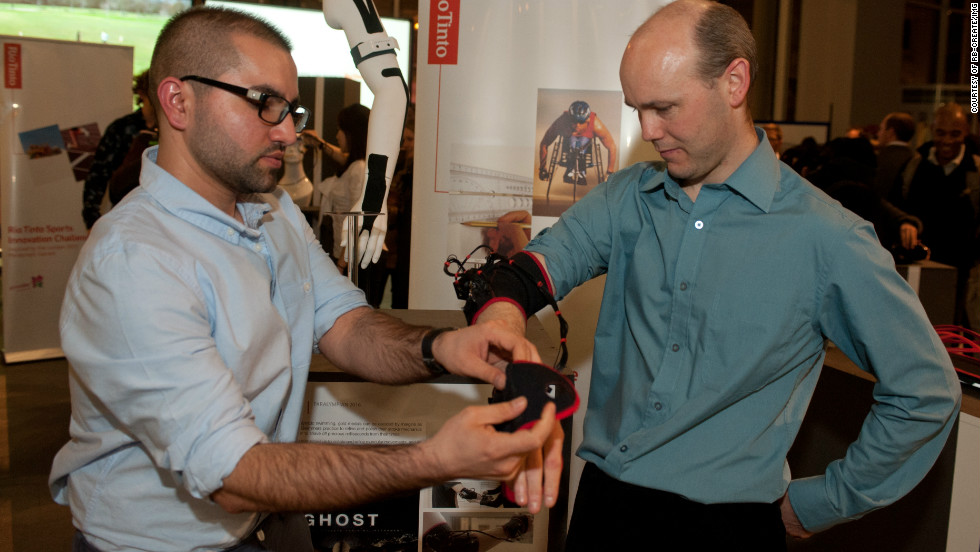 "British parathlete Iain Dawson (right) tries out the ""Ghost,"" which has been designed to help athletes train better. Vibrations and sound alert the wearer when a specific movement has been achieved. Students think it could help visually-impaired athletes like Dawson hone a swimming stroke. The idea was awarded ��5,000 ($8,000) by exhibition sponsor Rio Tinto."