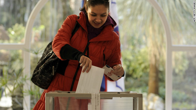 A woman casts her ballot at a polling station in the Black Sea resort of Sochi, on March 4, 2012.
