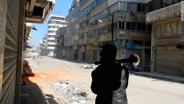A man carries a Rocket Propelled Grenade (RPG) in the al-Hamidiya neighborhood of the restive city of Homs, some 160kms north of the Syrian capital Damascus on February 25, 2012.