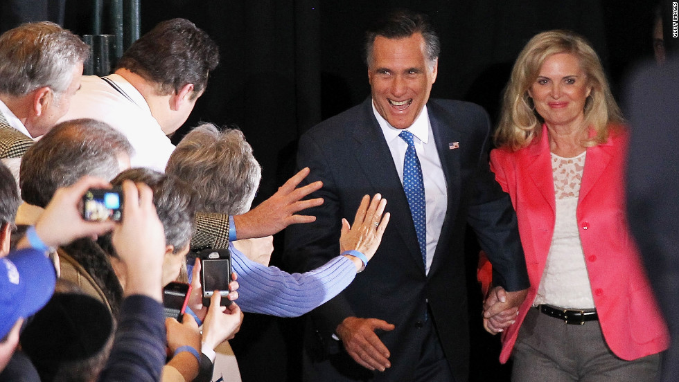 Republican presidential candidate and former Massachusetts Gov. Mitt Romney and his wife, Ann Romney, arrive at a Super Tuesday night gathering in Boston.