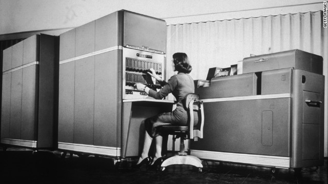 A woman operates an early IBM computer. Today, the tech industry remains dominated by men.