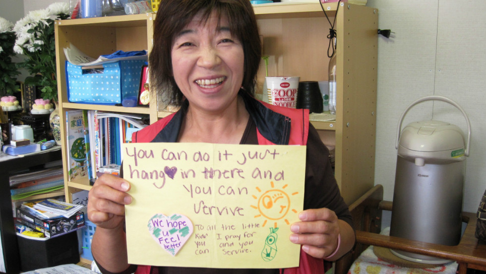 A woman in the small village of Ogatsu, Japan, is encouraged by the notes and letters sent from the United States.