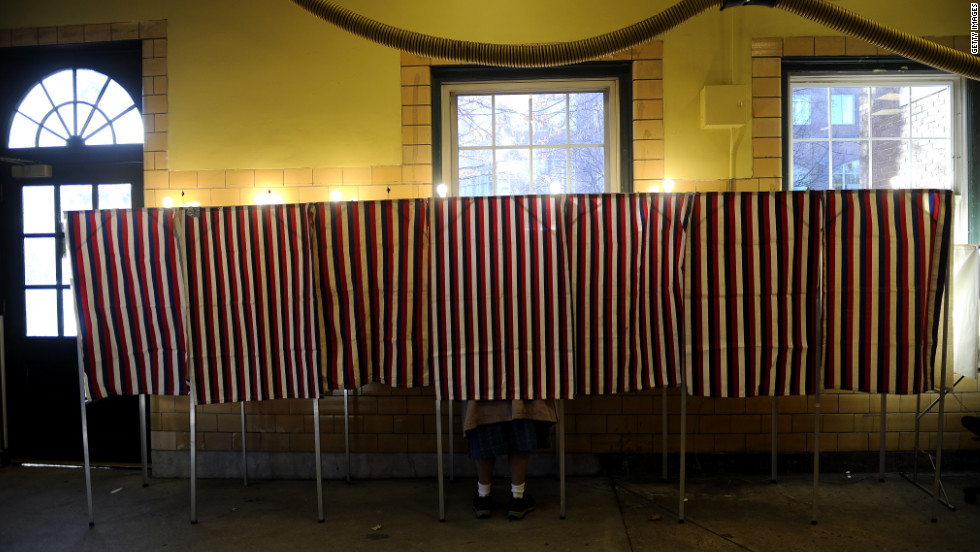A voter casts her vote at a polling station inside a Cambridge, Massaschusetts, fire station during the Super Tuesday Republican primary.