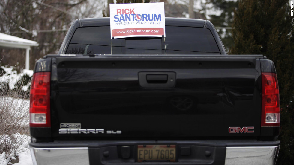 A political yard sign rides in the back of a pickup Tuesday in Bowling Green, Ohio.