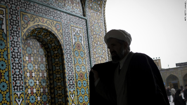 An Iranian clergyman in the courtyard of Massoumeh shrine in Qom, close to a nuclear facility.