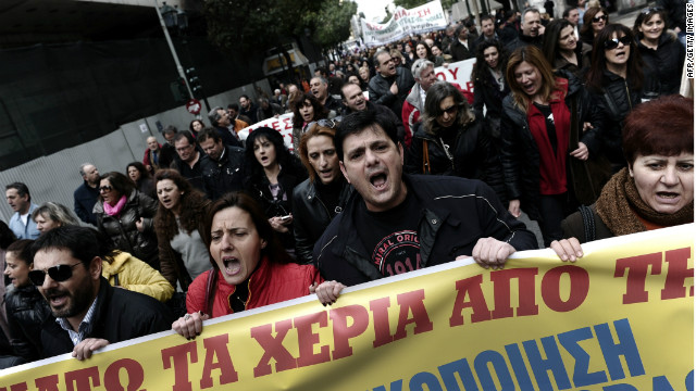 Greece's caretaker PM claims that most Greeks want to stay in the Eurozone, despite frequent anti-austerity demonstrations.