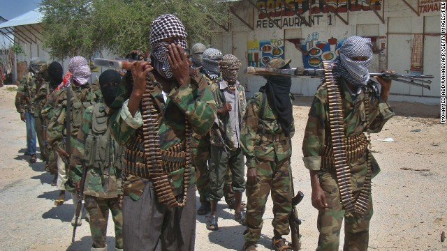 Al-Shabaab recruits walk down a street in the Somalian capital of Mogadishu after their graduation Monday.