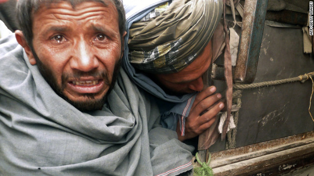 A man cries over the bodies of civilians allegedly shot by a rogue U.S. soldier on Sunday.