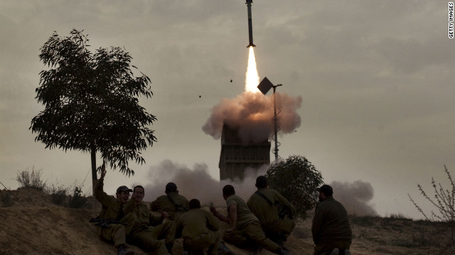 Israeli soldiers watch a missile launch from the Iron Dome defense system in the southern Israeli city of Beer Sheva on Monday.