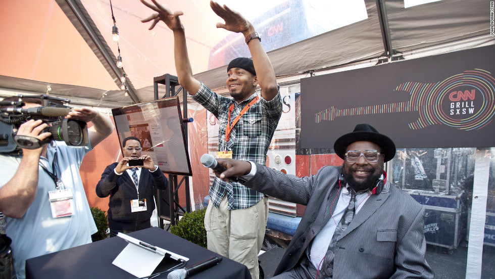 DJ Spooky and George Clinton get crowd feedback during their set Sunday.