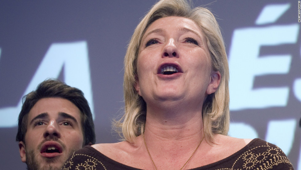 Marine Le Pen sings the French national anthem at her party's convention in Lille on February 18, 2012.