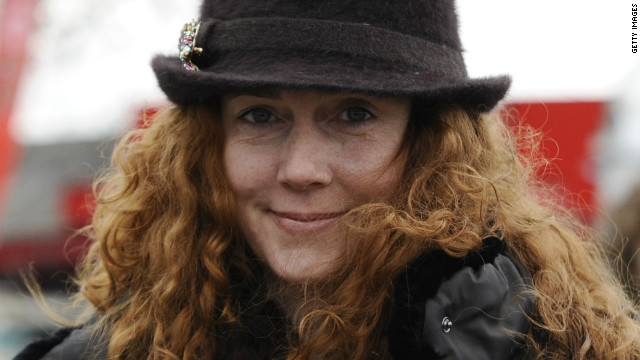 A day after Rebekah Brooks' arrest, a 51-year-old man was arrested on Wednesday on suspicion of intimidation of a witness