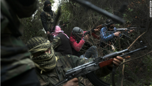 Members of the rebel Free Syrian Army, gather in a mountainous area of the restive Idlib on March 13, 2012.