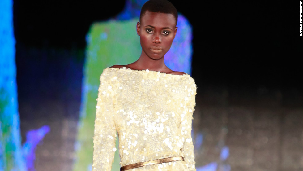 A model takes to the catwalk wearing a creation of South African designer Gavin Rajah.
