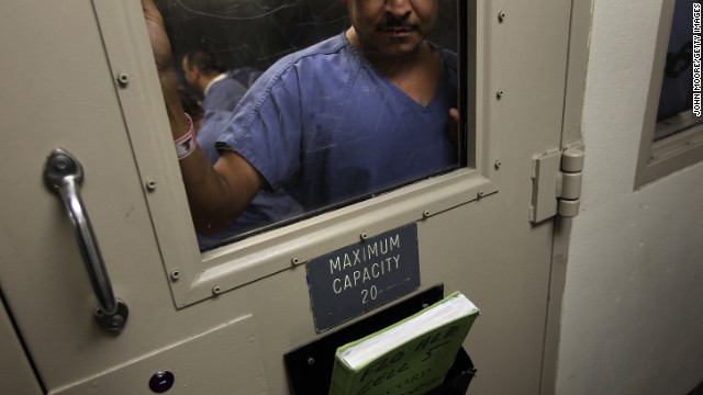 An immigrant is detained in a holding cell in Florence, Arizona, in 2010.