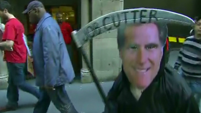 Occupy protests Romney's 'job cremation'