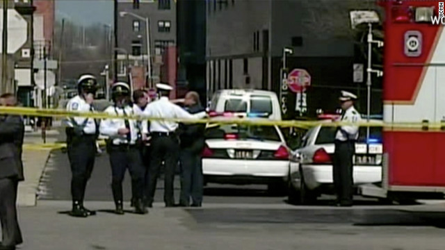 Columbus, Ohio, police officers confer at the scene where four people were stabbed Wednesday.