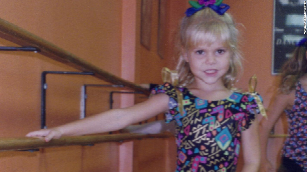 A young Kirsten strikes a ballet pose. She once dreamed of becoming a famous ballerina.