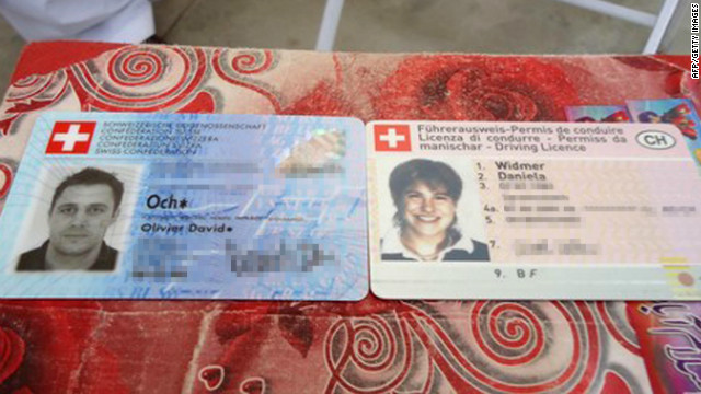 The Swiss identity cards of a couple, kidnapped by the Taliban, appear on a table at a police station in Quetta, Pakistan, in July.