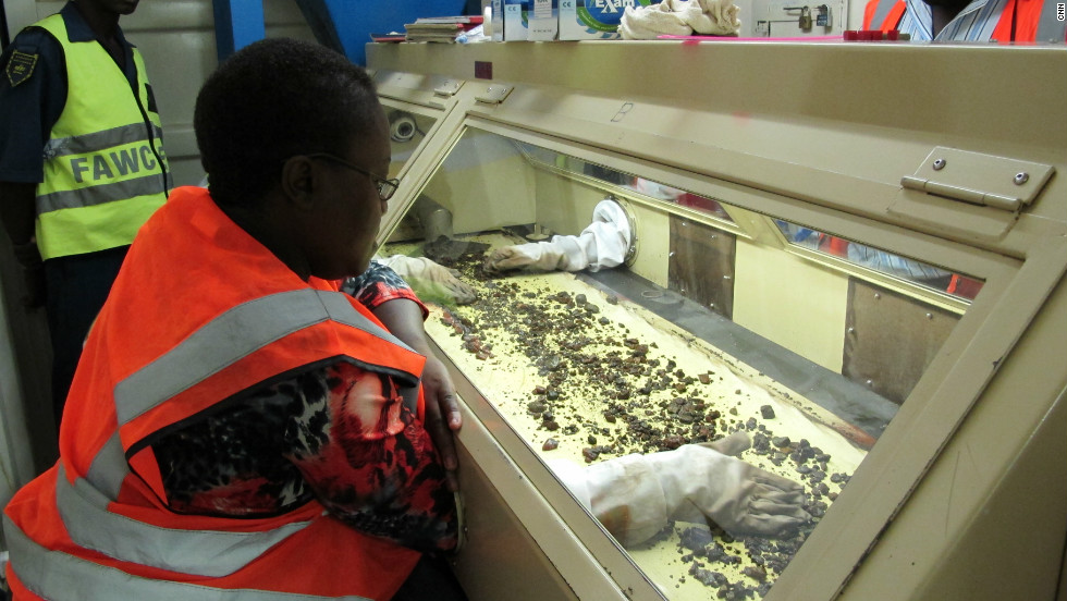 Diamonds are being sorted in a glass case. Marange Resources says no human beings are allowed to touch the diamonds during the extraction process.