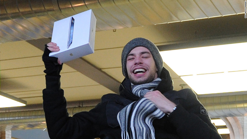 Londoner Craig Jobbins leaps in celebration after purchasing his new iPad.