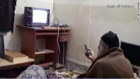 Bin Laden watches TV at his Abbottabad, Pakistan, compound in a frame grab from an undated video from the Pentagon.