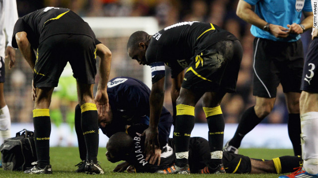 LONDON, ENGLAND - MARCH 17: Fabrice Muamba of Bolton Wanderers lies injured on the pitch during the FA Cup Sixth Round match between Tottenham Hotspur and Bolton Wanderers at White Hart Lane on March 17, 2012 in London, England. Fabrice Muamba suddenly collapsed and emergency services gave CPR treatment on the pitch, before taking him off on a stretcher, still unconscious. (Photo by Clive Rose/Getty Images)