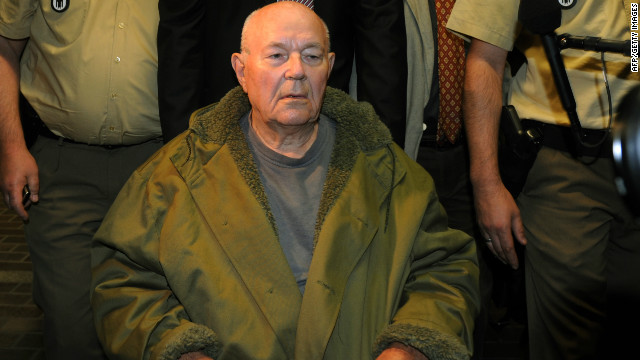 John Demjanjuk pictured leaving the court room after his trial in Germany in 2011.