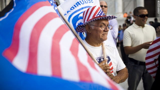 A man sells American flags at a Republican rally on Friday in San Juan, Puerto Rico.